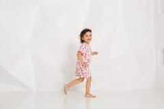 Beautiful little fashion model on white studio background. Royalty Free Stock Photos