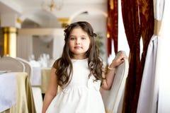 Beautiful little fashionista posing in restaurant Stock Photo