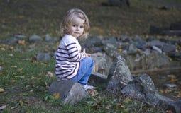 Beautiful little girl. In an autumn park Stock Photography