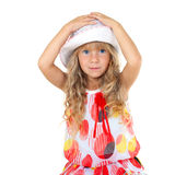 Beautiful little girl. Touching her head isolated on white background royalty free stock image