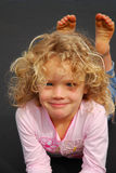 Beautiful little girl. Outdoor portrait of a beautiful little caucasian blond girl child staring with content and cute facial expression Royalty Free Stock Photos