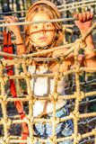 Beautiful little girl in the Adventure Park. Little girl is climbing in the adventure park royalty free stock photography