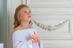 A beautiful little girl angel in white robe Stock Photos
