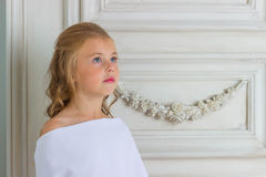 A beautiful little girl angel in white robe Royalty Free Stock Photography