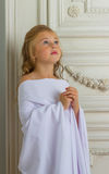 A beautiful little girl angel in white robe Stock Images