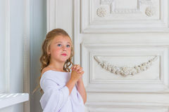 A beautiful little girl angel in white robe Stock Image