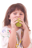 Beautiful little girl with apple Royalty Free Stock Photo