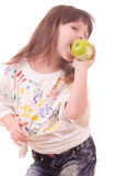 Beautiful little girl with apple Royalty Free Stock Image