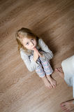 Beautiful little girl asks for forgiveness Royalty Free Stock Photography