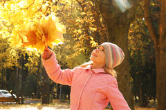 Beautiful little girl  in autumn park Royalty Free Stock Photos