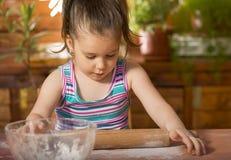 Beautiful little girl baking Royalty Free Stock Image