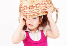 Beautiful little girl with a basket Stock Photos
