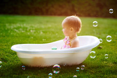 Beautiful little girl bathes in summer Royalty Free Stock Photo