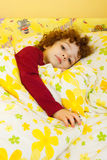 Beautiful little girl in bed Royalty Free Stock Photo