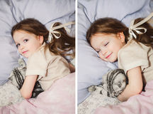 Beautiful little girl in bed with her pet Royalty Free Stock Photography