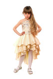 Beautiful little girl in a beige dress Royalty Free Stock Image