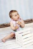 Beautiful little girl with big crayon Stock Photos