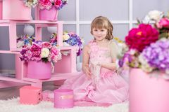 Beautiful little girl at a birthday party. stock photos