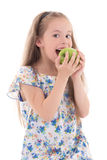 Beautiful little girl biting apple isolated on white Stock Photo