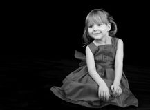 Beautiful little girl on a black background Royalty Free Stock Photo