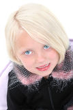 Beautiful Little Girl In Black Jacket With Feather Trim stock photography