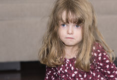 Beautiful Little Girl with Blond Hair and Blue Eyes Stock Images