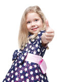 Beautiful little girl with blond hair showing thumbs up isolated Stock Photo