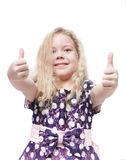 Beautiful little girl with blond hair showing thumbs up isolated Stock Photography