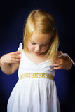 Beautiful little girl with blond hair Stock Photos