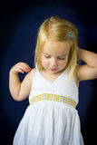 Beautiful little girl with blond hair Royalty Free Stock Photography