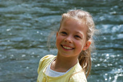 Beautiful little girl. Beautiful little blond girl with a river in the background Stock Photography