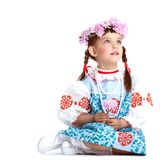 Beautiful little girl in blue slavic costume Stock Photography