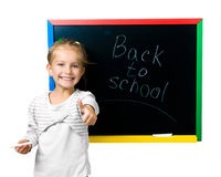 Beautiful little girl on a board Royalty Free Stock Image