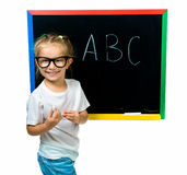 Beautiful little girl on a board Royalty Free Stock Photography