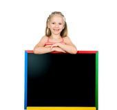Beautiful little girl on a board Royalty Free Stock Photo