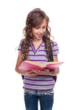 Beautiful little girl with book Royalty Free Stock Photography