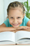 Beautiful little girl with book Stock Photos