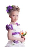 Beautiful little girl with bouquet Stock Photography