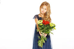 Beautiful little girl with a bouquet of flowers. Charming little girl with curly hair in a blue dress with a bouquet of flowers Royalty Free Stock Photos