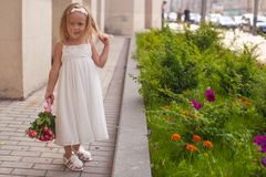 Beautiful little girl with bouquet of roses in her. Beautiful little girl with a bouquet of roses in her hand at the wedding Stock Photography