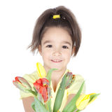 Beautiful little girl with a bouquet of tulips on white Stock Photos