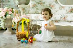 Beautiful little girl with Easter painted eggs royalty free stock photography