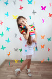A beautiful little girl in bright dress Stock Photo