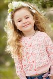 The beautiful little girl with bush blossoming tree stock image