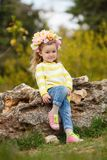 The beautiful little girl with bush blossoming tree royalty free stock image