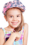 Beautiful little  girl in a cap over white Royalty Free Stock Photography
