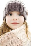 Beautiful little girl in cap and scarf. royalty free stock images
