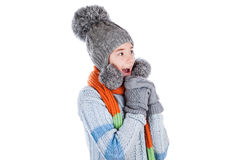Beautiful little girl in cap and scarf Royalty Free Stock Photo