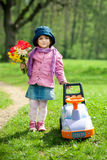 Beautiful little girl with car in park Royalty Free Stock Photo