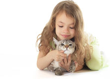Beautiful little girl with cat. Royalty Free Stock Image